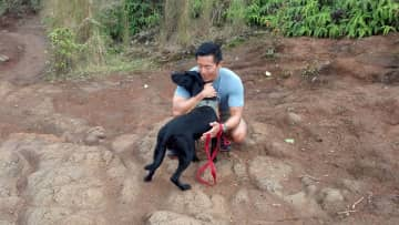 Norm with our 1-day Foster dog (Voodoo) on Kauai