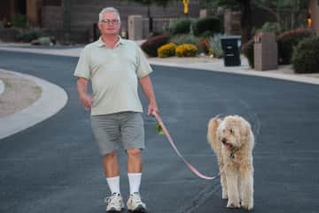 Mike loves to walk and enjoys canine company. Suki loves her walks.