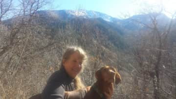 Lisa with Gunther in Millcreek Canyon Utah.  We took Gunther out for long hikes as well as his daily walks .