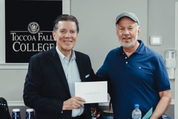 Retirement reception, May 2021. I'm on the right standing next to the college's president.