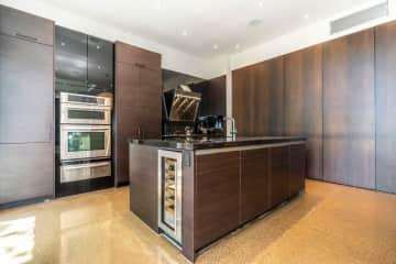 Kitchen, stove, oven, wine fridge.