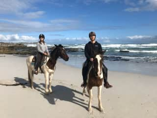 Ed and Anna riding horses in Gaans Baai