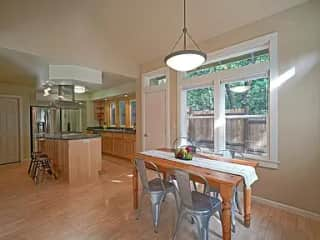 The home gets a lot of daylight as there are numerous windows throughout. This is the dining and kitchen area.