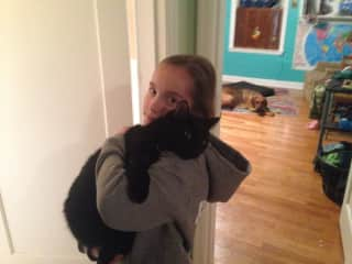 Our nine-year-old daughter, Paloma, with our sweet cat