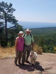 Kris and Bruce hiking with Tucker.