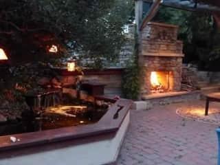 Backyard Fireplace and Pond