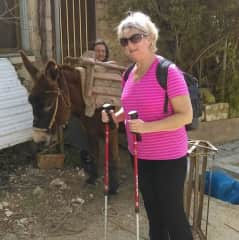 Walking through  a nearby village where we met a traditional local woman with her laden donkey