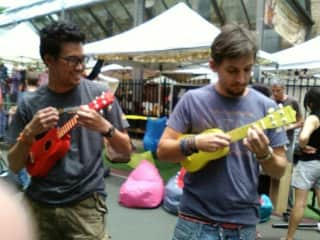 Justin and a friend jamming a long at the markets