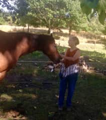 Akia with a lovely bay horse I cared for.
