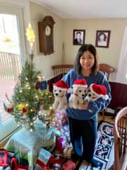 Mom with her white lab, Santa hat crocheted creations