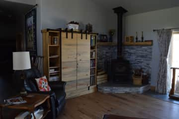 Living Room with wood stove and entertainment center.