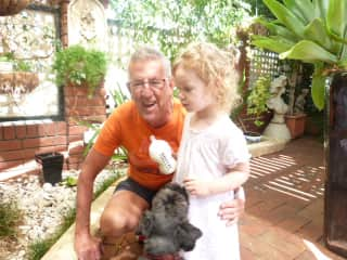Russell with our granddaughter and Panza our dog