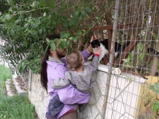 Nine and street cat in Greece