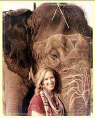 Feeding, bonding with and painting an elephant in India.