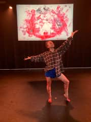 Posing with artwork I painted live on-stage during a dance performance