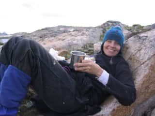 This is me, Margot, reading at a campsite with my husband in Wyoming a few years ago.