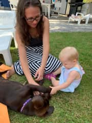 Mommy teaching Eva how to interact with a Labrador puppy. It is amazing how animals know they are dealing with a baby! Colby was so calm around her.