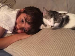 Thomas snuggling Fluffy
