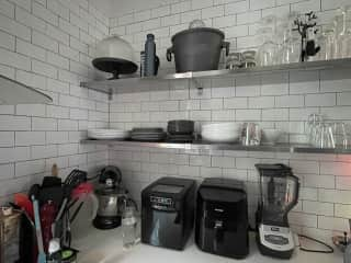Open shelves for NON-daily china. Daily use china are kept in easy-to-reach lower cabinets.
