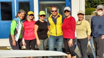 Me in red heading out sculling in Maple Bay with my rowing buddies.
