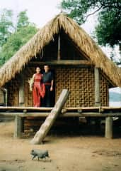 Mars and Dan getting married in 1999 getting by the Muong tribal chief in hills of Vietnam. Standing in front of their own personal long-house!