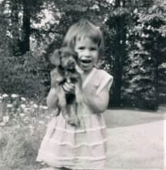 This is Griffin at age 2 with her favorite puppy