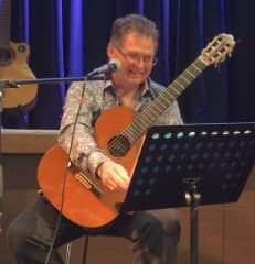 David performing with his classical guitar
