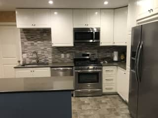 Kitchen has all stainless steel appliances and is open concept to dining room and living room.