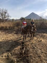Enjoying nature on a horse back in the shadow of a volcan