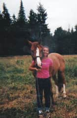 Kali and her horse childhood horse Rainy in 2003.