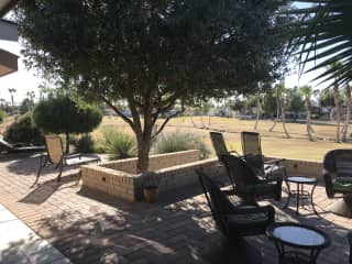 Patio and golf course has sunset views