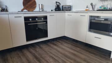 Kitchen with double door fridge oven and microwave