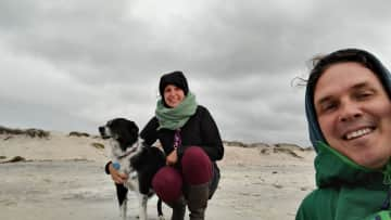 This is Missy (Monterey, CA - TrustedHousesitters Sit) and us at the beach on a chilly day.