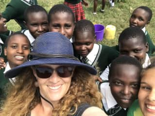 Me and my daughter in Kenya visiting a girls school. We were volunteering with giraffe surveys and conservation with a local Maasai community.