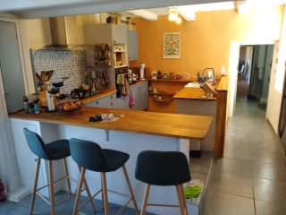 Kitchen and bar area. Kitchen has the usual amenities, except no  microwave. Gas stove, electric oven.