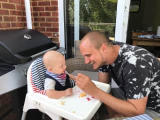 Feeding time with my nephew Alex! I'm not sure whether there's more going in his mouth or over me.