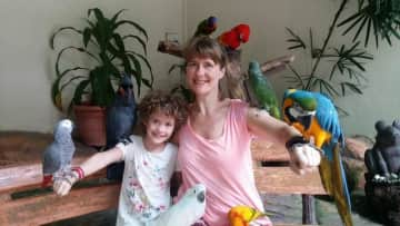 My daughter and I enjoying the company of parrots.