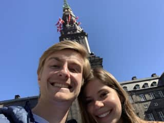 Traveling in Copenhagen, Denmark in front of Christiansborg Palace