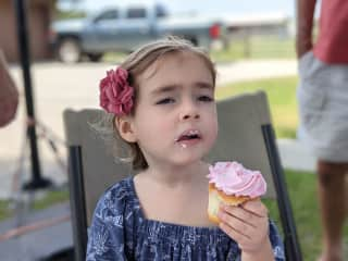 Our daughter enjoying a cupcake!