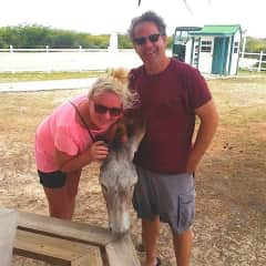Pierre Mathiueu & Dawna Henderson with one of the feral donkeys in Grand Turk, Turks & Caicos Islands