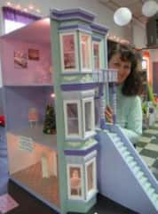 Me and one of the dollhouses I rehabbed