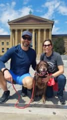 Bill and Lisa with Nola, the Chocolate Labrador whose favorite activity is playing fetch in the park