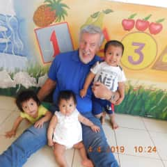 Carl, sharing some love with malnourished children at Nutre Hogar Home in David, Panama