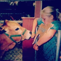 Me at 11 with my first heifer, Buttercup at the county fair.