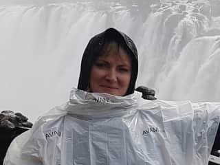 Walking round Victoria Falls in Zambia (very wet!).
