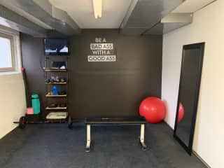 Small private home gym located in the basement - equipment all available for use with HDMI cable hook up to the TV