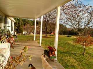 Front porch overlooks field & woods