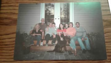 Our family photo with Chocolate Lab Taylor, taken when all the kids were home. We always had a variety of great pets.