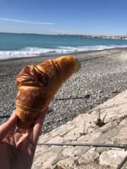 Eating while traveling 🤤 A fresh croissant on the French Riviera.