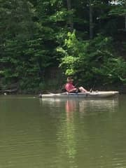 Danny fishing and kayaking, we love spending time on the water!
